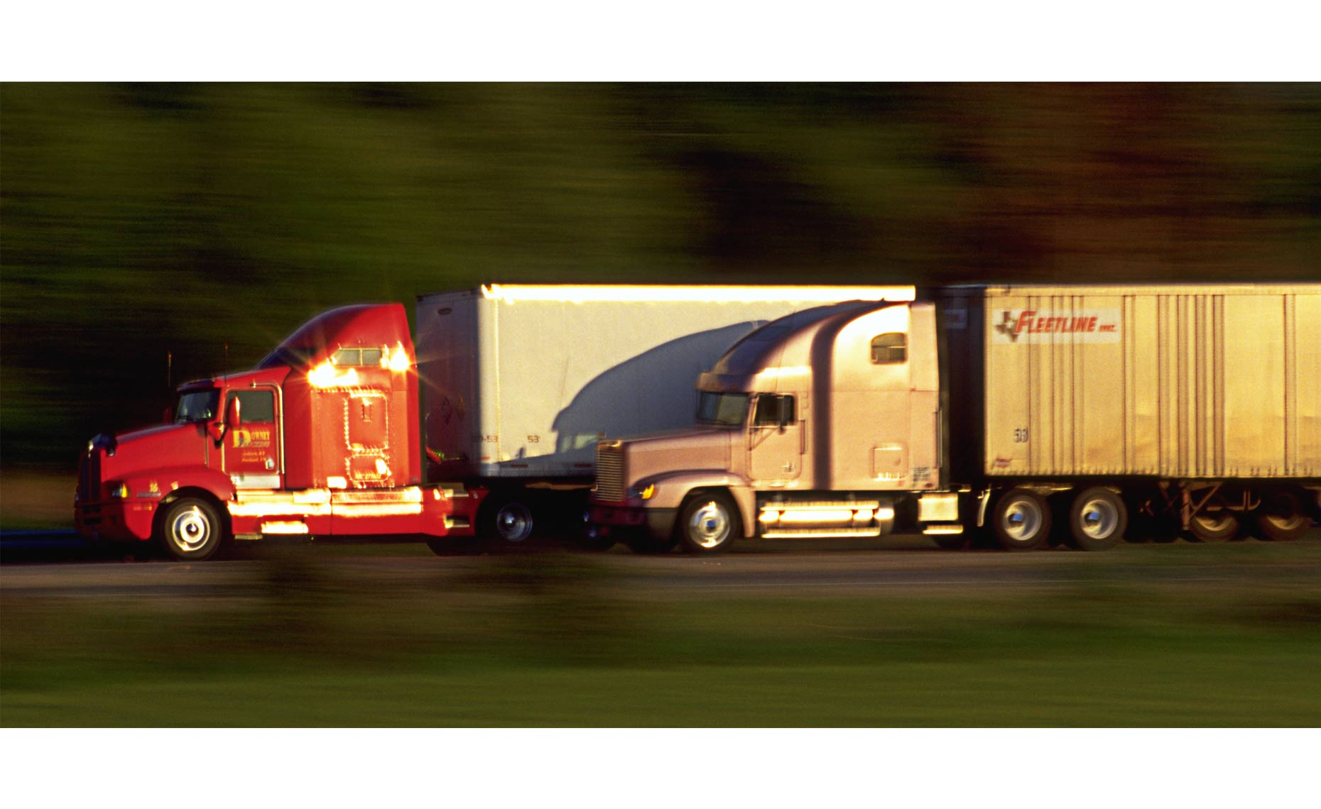 2-trucks-in-motion