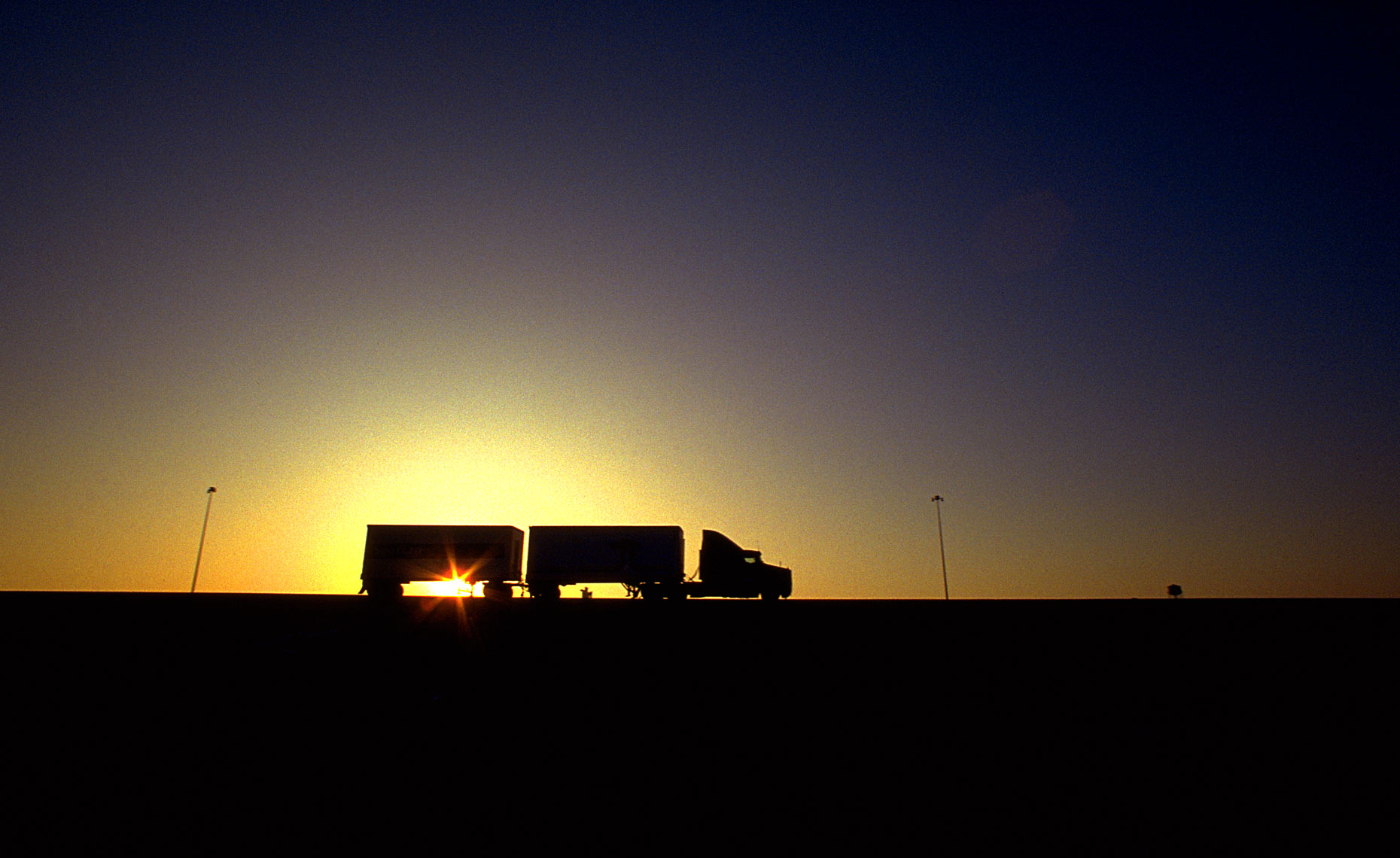 Semi-trucks-sunset-sky-1