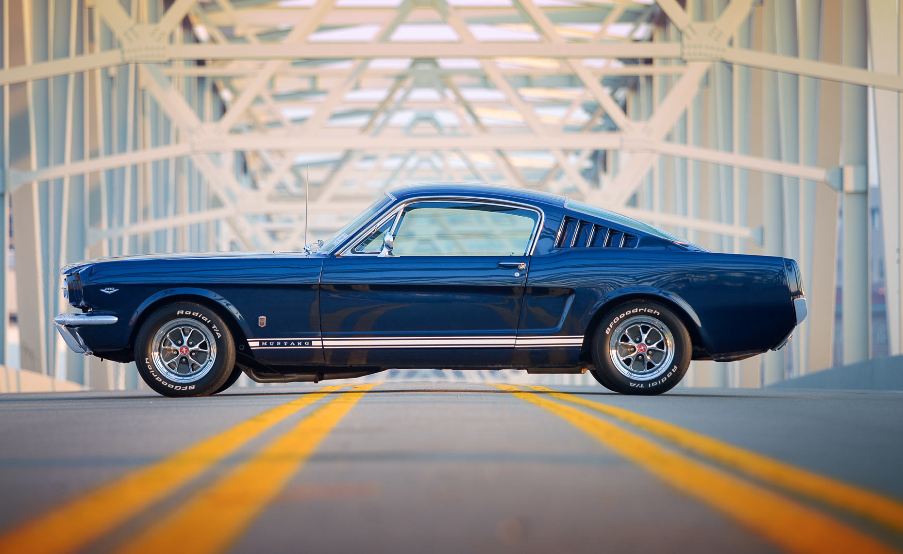 blue-mustang-on-bridge-side